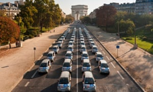 Autolib' electric cars in front of the Arc de Triomphe in Paris