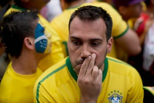 Mourning Brazil: Germany scored a fourth goal in the 26th minute. This fan had to turn away
