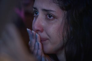 Mourning Brazil: a Brazilian fan reacts while watching the humiliation of her team