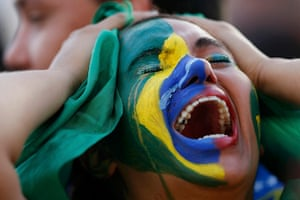 Mourning Brazil: Fans of Brazil react while watching the 2014 World Cup semi-final