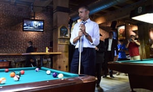 Barack Obama plays a game of pool at a local pub in Denver, Colorado
