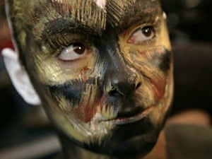 Model Lowri Thomas seen part way ready in her tarantula transformation on in Leicester, England.  A CONTORTIONIST is transformed into a human tarantula. The super-sized spider is the handiwork of body painter Emma Fay, 27, who used water-based paints to turn the ultra-flexible model into the giant arachnid. The set also includes some of Fay's other stunningly realistic animal transformations, including a spiralling seahorse and a giraffe. The Leicester-based artist, who has been body painting for three years, spends around five hours on each work and created the series to celebrate the marvels of the natural world.