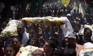 Relatives and friends of the al-Kaware family carry the 7 bodies to the mosque during their funeral in Khan Yunis