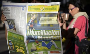 A Colombian reads a newspaper a day after Germany beat Brazil with a record 7-1 victory