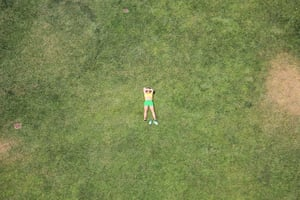 Your Pictures: Sunbathe: Aerial view of a woman sunbathing on grass