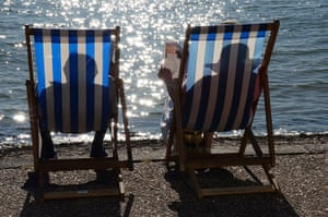 Your Pictures: Sunbathe: Silhouette of people sat in deckchairs