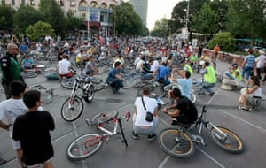 Cyclists block a bridge in Tirana during a protest to demand more cycle paths in the city.