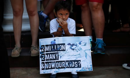 Mexican child at migration protest