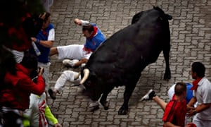 Bill Hillmann is gored in his right thigh by a bull during the third day of the San Fermin festival.
