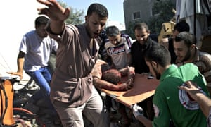 Emergency responders carry a man found under the rubble of his house, following an Israeli airstrike