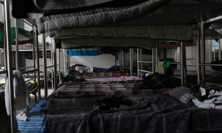 A migrant sleeps on a bunk bed inside a Catholic migrant shelter in San Luis Potosi.