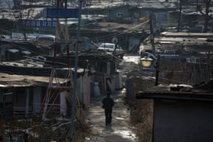 The dilapidated homes in Guryong are built out of plywood, metal, sheets of plastic and cardboard boxes, yet residents have even established a postal service.