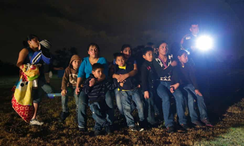 A group of immigrants from Honduras and El Salvador who crossed the US-Mexico border illegally are stopped in Texas.