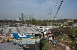 Guryong slum spreads out beneath the skyscrapers of Gangnam.