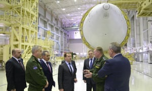 Russian Prime Minister Dmitry Medvedev (C) and other officials visit the Angara assembly shop in the Arkhangelsk region, Russia in February 2014. Photograph: Alexander Astafyev/Ria Novosti/Government Press Service/Pool/EPA