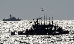 Israeli navy vessels in the Mediterranean, visible from the southern border of the Gaza Strip.