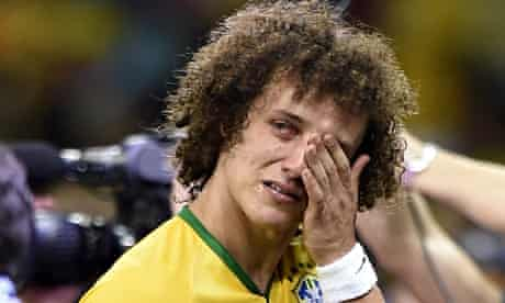 The emotion of defeat overcomes Brazil's David Luiz.