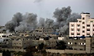 Smoke billows from buildings following an Israeli air strike in Gaza City. palestine