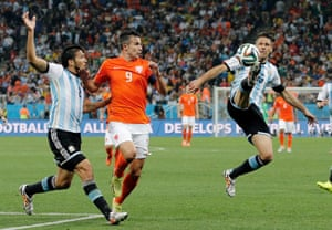 Argentina's Martin Demichelis cuts out a rare threat in the first half.