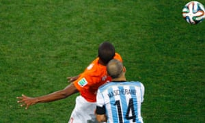 Georginio Wijnaldum and Javier Mascherano clash heads.