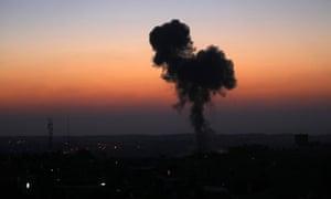 Smoke billows from buildings following an Israeli air strike in Rafah, in the southern Gaza Strip.