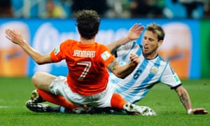 Netherlands' Daryl Janmaat, left, collides with Argentina's Lucas Biglia in a game heavy on tackles and poor on quality.