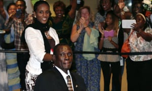 Meriam Ibrahim and her husband Daniel Wani are greeted as they arrive in the US.
