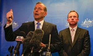 Prime Minister Tony Abbott (left) and Tasmanian Premier Will Hodgman speak to the media at the Hobart Traffic Management Centre in Hobart, Tasmania, Thursda
