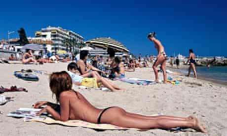 Sunbathers on Plage du Midi, Cannes Cote d'Azur, France