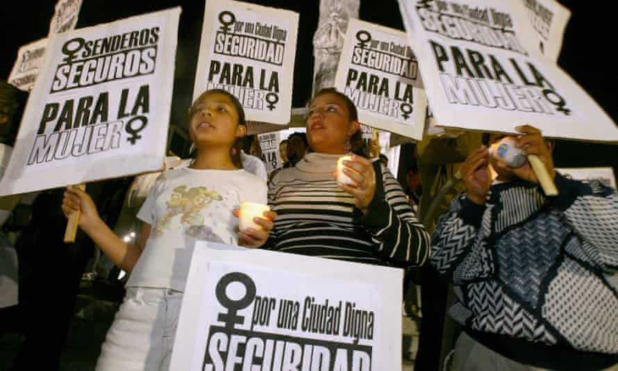 Women march to protest violence against women in Mexico City.