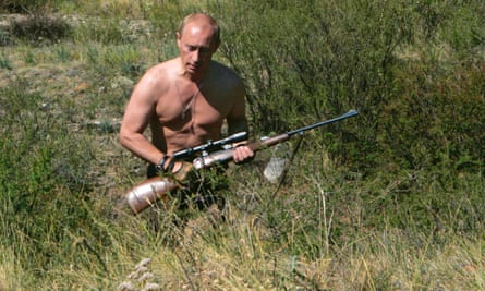 Vladimir Putin carries a hunting rifle during his trip in Ubsunur Hollow in the Siberian Tyva region in 2010.