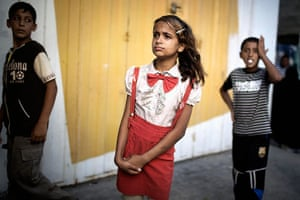 20 photos: Palestinian children look at the scene of an explosion