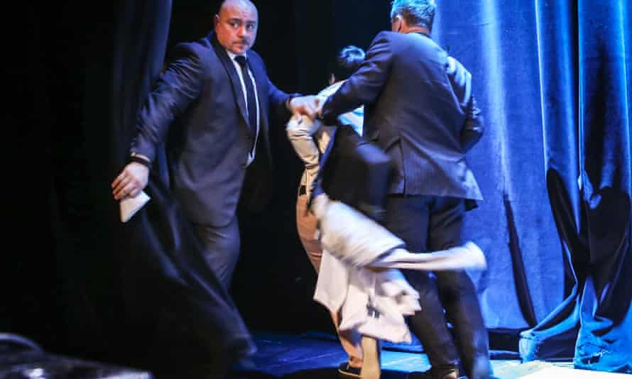 'Security guards tell a truer story than brochures' … a protester is bundled off stage at Barrick Gold's 2014 AGM in Toronto.