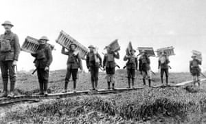File photo dated 01/01/16 of a carrying party of British troops taking a batch of duck-boards across marshy ground, during the Battle of the Somme.