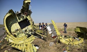 Australian and Dutch investigators examine pieces of the wreckage of MH17