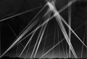 British civilian defence forces fire on German Navy airship caught in searchlights overhead during WWI, 1916.Archive photograph (unknown photographer) selected by Sarah Pickering.