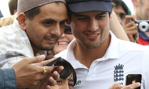 England captain Alastair Cook poses for photographs after the defeat of India at Old Trafford