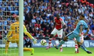 Now Arsenal's Welsh midfielder Aaron Ramsey, second right behind Manchester City's French defender Gael Clichy , shoots to score their second goal.