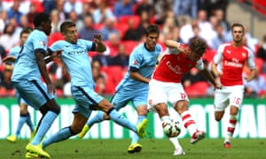 Olivier Giroud of Arsenal scores the third goal of the match.