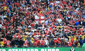 Arsenal fans celebrate by doing the 'Poznan'.
