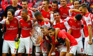 Arsenal players celebrate with the Community Shield after a 3-0 victory over Manchester City.