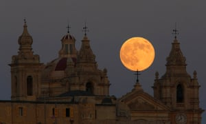 The supermoon rises behind the cathedral in Mdina, Malta's ancient capital city, in the centre of the island.