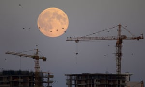 The supermoon is seen behind a building site in Minsk, Belarus.