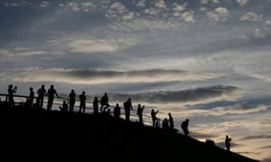 People wait for the upcoming Super Moon at the Olympic Park in Munich, Germany.