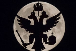 A two-headed eagle, the national symbol of Russia, is seen in front of the supermoon as it rises over the Historical Museum in Moscow.