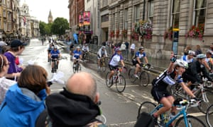 Cyclists make their way down Whitehall at the end of the Ride London 100.