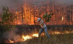 A Russian man tries to stop fire near village Dolginino on August 4, 2010. Russia's worst heatwave for decades shows no sign of relenting, officials warned as firefighters battled hundreds of wildfires in a national disaster that has claimed at least 40 lives.