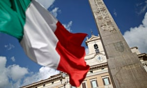 An Italian flag waves in front of the Montecitorio palace