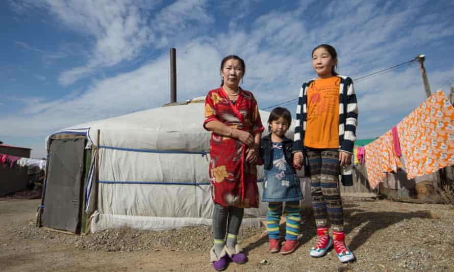 Dolgorsuren Dalkhaa, 49, with grandchildren Anudari Batbaatar, 4, and Bolortsetseg, 9 are among tens of thousands of rural migrants who live in 'ger' tents on the edge of Ulaanbaatar.
