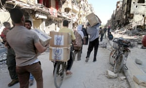 The United Nations Relief and Works Agency for Palestine refugees in the near east (UNRWA) provide food assitance for Palestinian refugee camp of Yarmouk in Damascus, Syria on July 8, 2014.